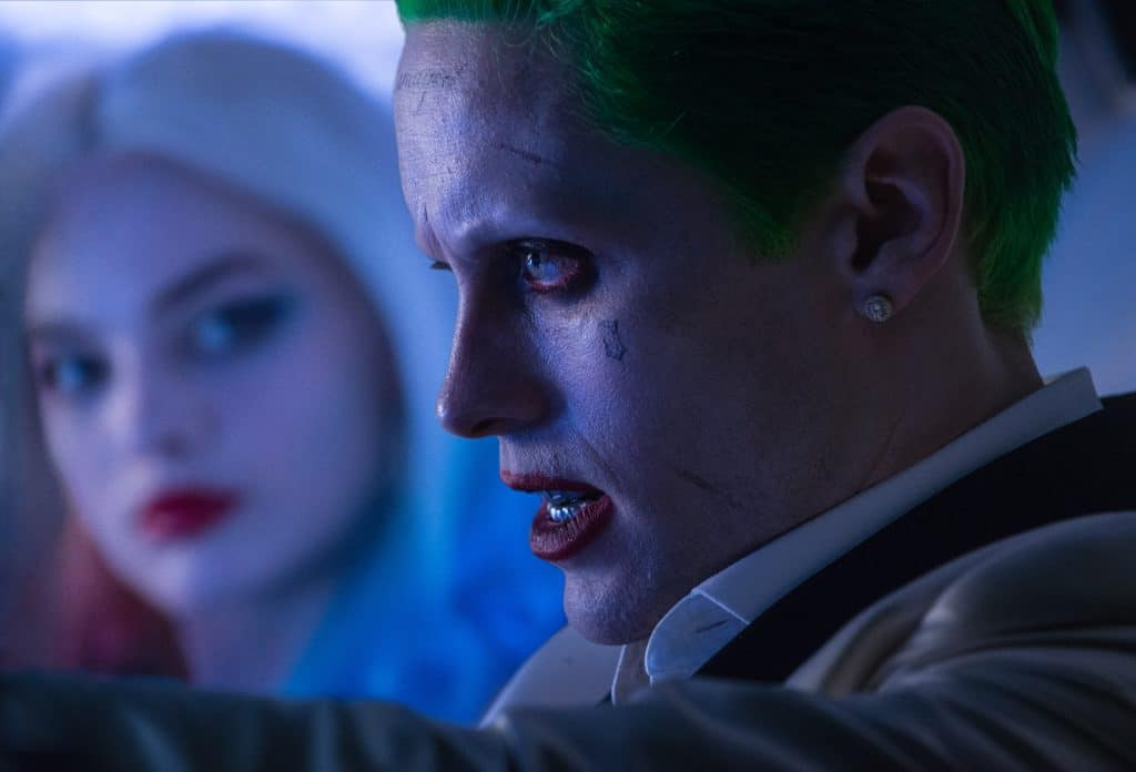 """(L-r) MARGOT ROBBIE as Harley Quinn and JARED LETO as The Joker in Warner Bros. Pictures' action adventure """"SUICIDE SQUAD,"""" a Warner Bros. Pictures release. Photo credit: Clay Enos/ TM & (c) DC Comics"""