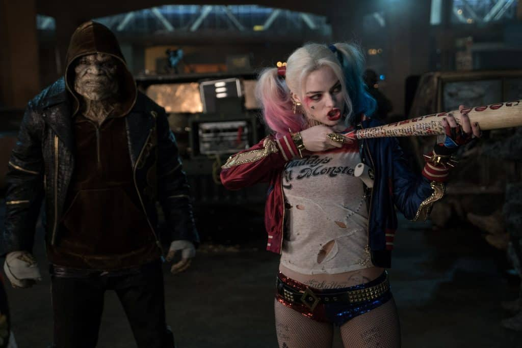 """(L-r) ADEWALE AKINNUOYE-AGBAJE as Killer Croc and MARGOT ROBBIE as Harley Quinn in Warner Bros. Pictures' action adventure """"SUICIDE SQUAD,"""" a Warner Bros. Pictures release. Photo credit: Clay Enos/ TM & (c) DC Comics"""
