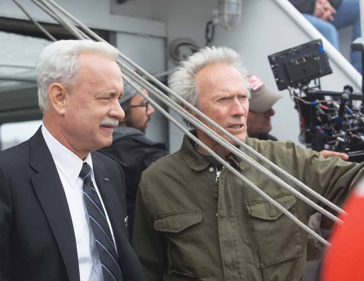 (L-R) Tom Hanks with director/producer, Clint Eastwood on the set of Warner Bros. Pictures' and Village Roadshow Pictures' drama SULLY, a Warner Bros. Pictures release. Photo by Keith Bernstein